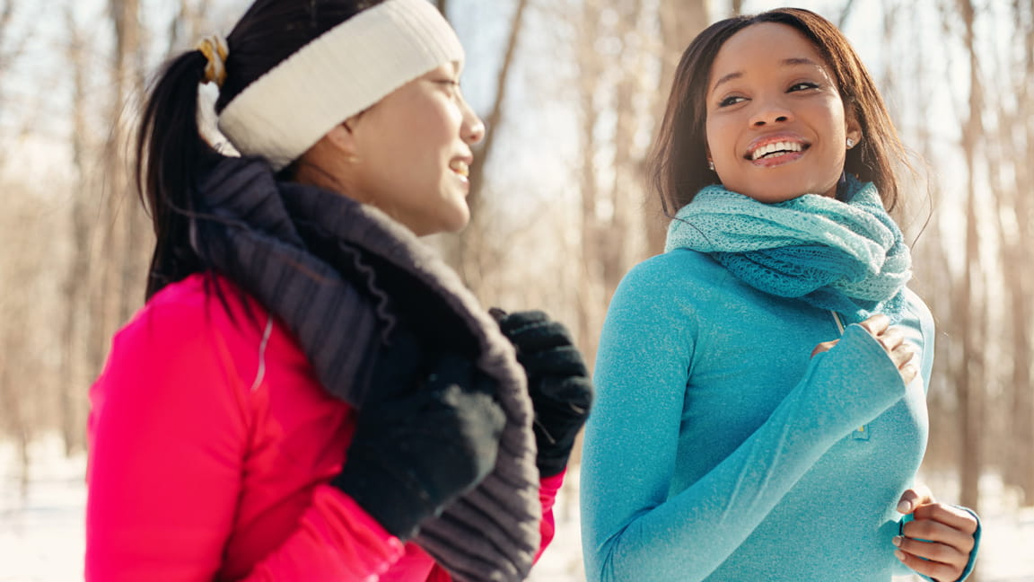 women exercising outdoors in cold weather