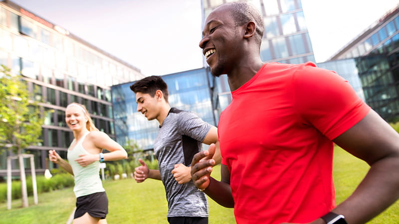 Multi-ethnic friends running or jogging outdoors