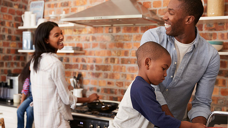 happy African-American family cooking