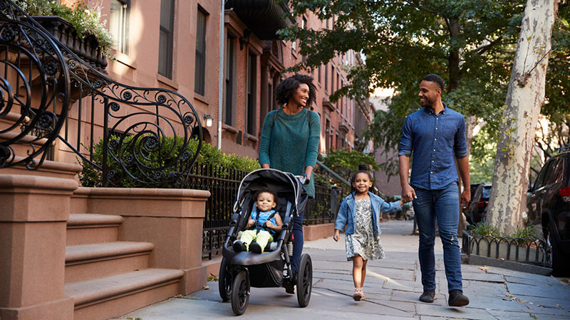 happy family walking in urban outdoors