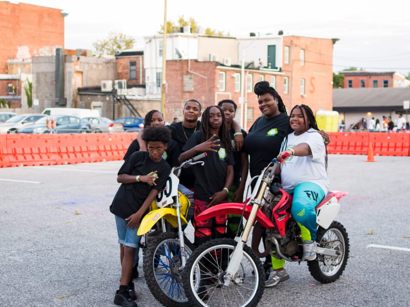 Brittany Young (second from right) at a dirt bike showcase in Baltimore. (Photo courtesy of Javon Roye)