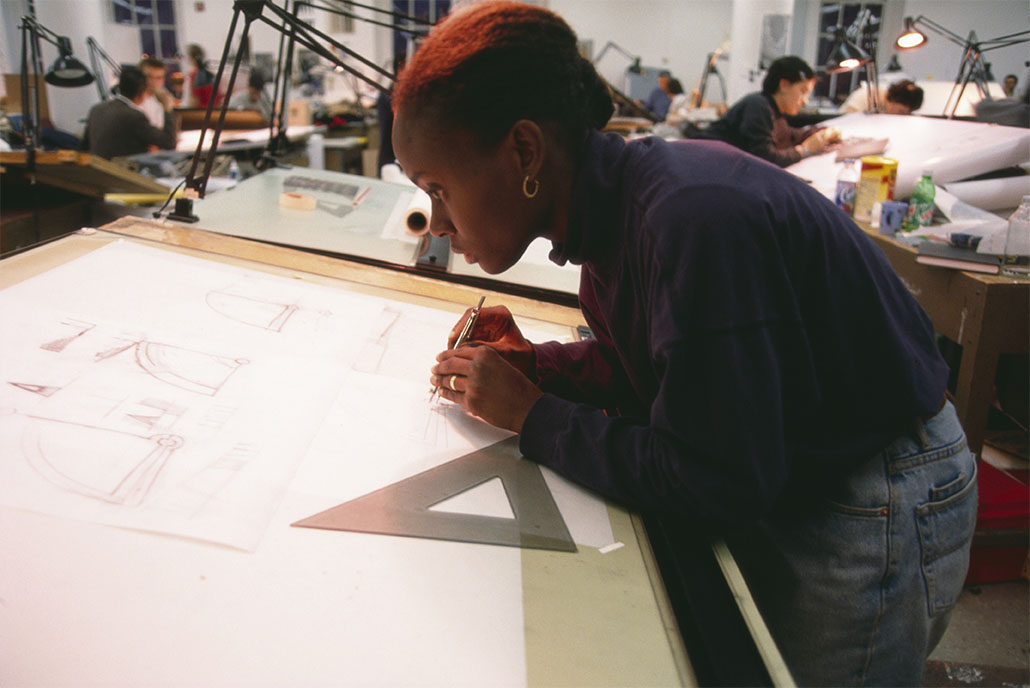 Woman working on a drawing board